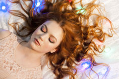 Beautiful girl lying on the bed Royalty Free Stock Photo