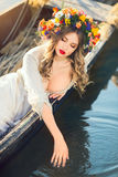 Beautiful girl lying in boat Royalty Free Stock Images