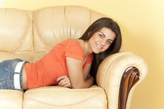 Beautiful girl lying on the couch Stock Image