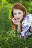 Beautiful girl lying down at grass. Stock Photo