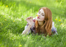 Beautiful girl lying down at grass. Royalty Free Stock Photo