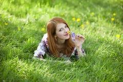 Beautiful girl lying down at grass. Royalty Free Stock Image