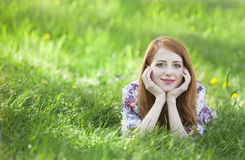 Beautiful girl lying down at grass. Royalty Free Stock Images