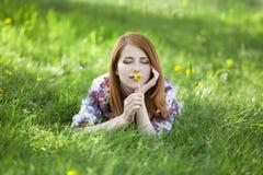 Beautiful girl lying down at grass. Stock Image