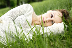 Beautiful girl lying down of grass Stock Image