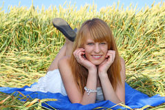 Beautiful girl lying in the field Royalty Free Stock Photography