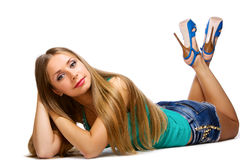 Beautiful girl lying on floor Stock Image