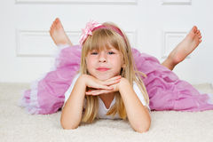 Beautiful girl lying on floor Royalty Free Stock Images