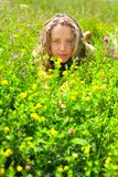 Beautiful girl lying among the flowers and herbs Stock Photos