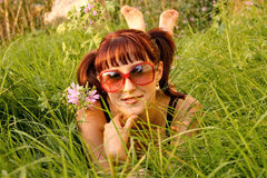 Beautiful girl lying in grass Stock Photography