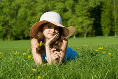 Beautiful girl lying on grass Royalty Free Stock Photos