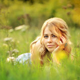 Beautiful girl lying in grass Royalty Free Stock Photography
