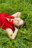Beautiful girl lying on the grass Royalty Free Stock Photography