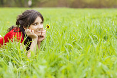 Beautiful girl lying on the grass Stock Image