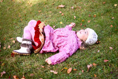 Beautiful girl lying on grass in autmn park Royalty Free Stock Image