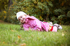 Beautiful girl lying on grass in autmn park Stock Photography