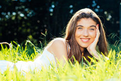 Beautiful girl lying in the grass Stock Photography