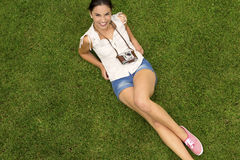 Beautiful girl lying on the grass Stock Photography