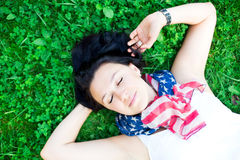 Beautiful girl lying on a grass Stock Image