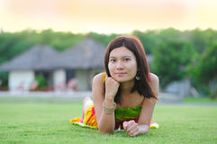 Beautiful girl lying on the grass Stock Images