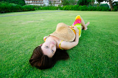 Beautiful girl lying on the grass Royalty Free Stock Image