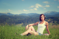Beautiful girl lying on green grass. Field Royalty Free Stock Photography