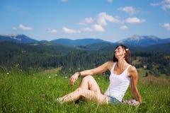 Beautiful girl lying on green grass field. Beautiful girl lying on green grass summer field stock image