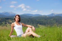 Beautiful girl lying on green grass field. Beautiful girl lying on green grass summer field stock photography