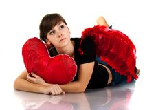 Beautiful girl lying with heart pillow Stock Image