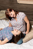 Beautiful girl lying on her mother's lap. Family fun Stock Photography