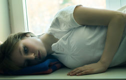 Beautiful girl lying and longs Royalty Free Stock Photo