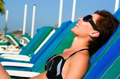 Beautiful girl lying on a lounger Stock Photography