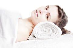 Beautiful girl lying on a massage spa. Young beautiful girl lying on a massage table at spa Royalty Free Stock Image