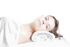 Beautiful girl lying massage spa. Young beautiful girl lying on a massage table at spa Stock Photography