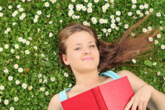 Beautiful girl lying in a meadow full of flowers Royalty Free Stock Photography