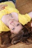 Beautiful girl lying outside Royalty Free Stock Image