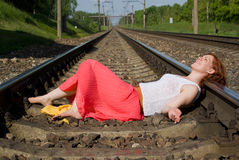 Beautiful girl lying on the rails Stock Image