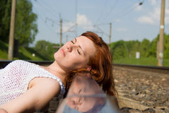 Beautiful girl lying on the rails Stock Images