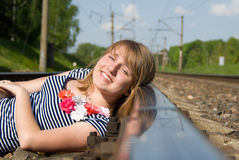 Beautiful girl lying on the rails Royalty Free Stock Images