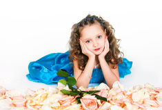 Beautiful girl lying in rose-peta Royalty Free Stock Image