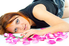 Beautiful girl lying in rose petals Stock Photography
