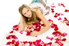 Beautiful girl lying with rose petals Royalty Free Stock Photo