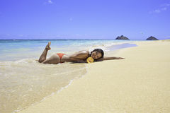 Beautiful girl lying on the sand Stock Photo