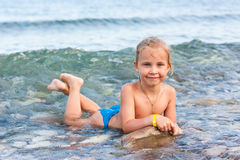Beautiful girl lying at the seashore Royalty Free Stock Image
