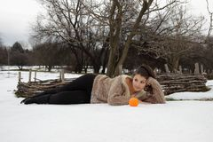 Beautiful girl lying in the snow Stock Images