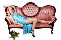 Beautiful girl lying on a sofa. Royalty Free Stock Photo