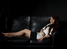 Beautiful girl lying on a sofa Royalty Free Stock Photo