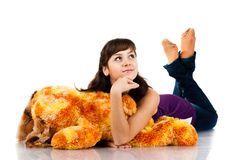 Beautiful girl lying on a soft toy Royalty Free Stock Photo
