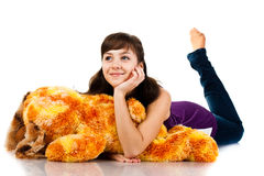 Beautiful girl lying on a soft toy Royalty Free Stock Image