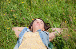 Beautiful girl lying on the summer meadow. Beautiful girl lying on the green summer meadow Stock Images